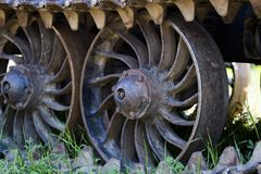 Wheels of the tractor. Close-up details of the wheels and tracks of the tractor tracks. Caterpillars, tracks and links of tractor tracks. Caterpillar tractor Royalty Free Stock Photos