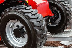 Wheels of the tractor drive onto Stock Photo