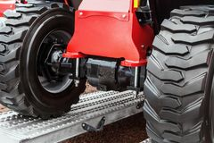 Wheels of the tractor drive onto Stock Images