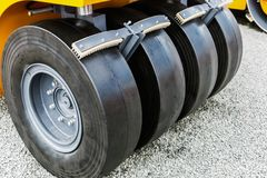 Wheels of the tractor or roller of the paver Stock Photos