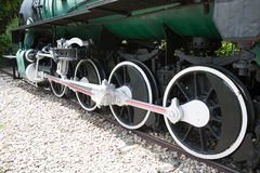 Wheels of the Train. Black and White and green Royalty Free Stock Image