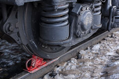 Wheels of the train. Chock the wheels of the railcar Royalty Free Stock Photography