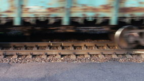 Wheels of the train moving along the rails closeup. Train with containers passing by.Train rides on the railroad.Freight train stock footage