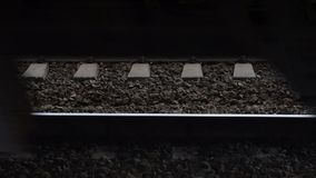 Wheels of train moving on high speed. Rail tracks and train passing by on high speed, view to the wheels stock video footage