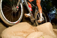 Wheels traversing rock section UCI MTB World Cup Stock Photography