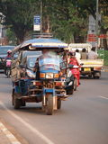 3-wheels vehicle and daily life on a market near M Stock Image
