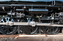 Wheels of Vintage Steam Engine Move By Stock Photography