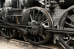 Wheels of vintage steam engine on railway. Black wheels of vintage steam engine on railway stock photos