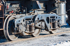 Wheels and wheel trolley heavy railway freight car. Royalty Free Stock Photo