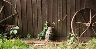 Wheels, wood and lamp. Rustic still life. two old wheels and lamp on wood background Stock Photography