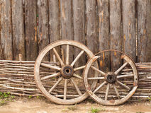 Wheels in the wooden log house in Russian village in the middle Stock Photography