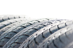 Whell. Closeup of row of new car tires Royalty Free Stock Photo
