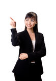 This is where we are. Asian business woman pointing at something Royalty Free Stock Photography