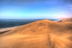 Where desert meats ocean Stock Images