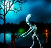 Where Do We Come From?. Digital painting of an alien showing astrological data to an ancient tribal woman Royalty Free Stock Photos