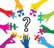Where do you put colored pieces. Team play with colorful puzzle pieces Stock Images