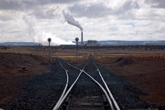 Where electricity comes from. Hour glass shaped train tracks leading to coal burning power plant in eastern arizona Stock Photos