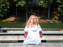 Where is everybody. A little girl waiting for friends to show up Royalty Free Stock Image