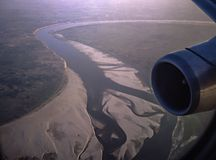 The river Ganges from the Air. `Where the ganges makes a broad sweep to the North, there lies Banaras ..&#x22 Stock Photography