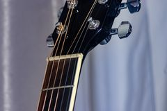 Guitar neck meets guitar head. Where the guitar neck meets guitar head royalty free stock photography