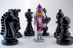 Where am I?. Chess pieces surrounding nutcracker cute composition Stock Image