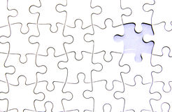Where are last jigsaw. Jigsaw background with lacking final pne Stock Photos