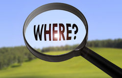 Where. Magnifying glass with the word where on blurred nature background. Searching where concept royalty free stock photos