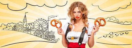 Where is my beer?. Beautiful offended Oktoberfest waitress wearing red jumper shorts with suspenders as traditional dirndl, holding two pretzels, pouting against royalty free stock photography