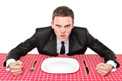 Where is my food?. An angry man waiting his food in a restaurant Stock Images