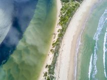 Fresh or Salty water- aerial views of ocean and river. Where ocean meets river, separated by a narrow sand dune. Aerial views showing snd wave patterns and royalty free stock photography