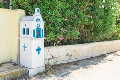 Small blue and white traditional orthodox church on the road, in the Corfu, Greece. royalty free stock photography
