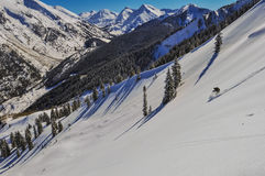Where she plays. Single skier in Colorado back-country near Aspen, Co Stock Image