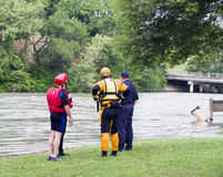 Where is the raft?. An emergency team preparing for a drill of water rescue on a flooded fast moving river Stock Photography