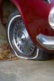 Where The Rubber Meets The Road. Older car with a flat tire Stock Images