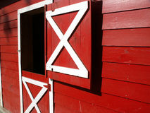 Where's the horse?. Looking down the side of a red barn with window open royalty free stock images