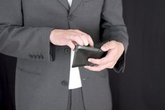 Where's the Money? (1). Handsome business man in suit, checking where all his money went royalty free stock photography