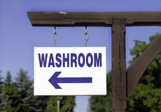 Where's The Washroom?. A signpost showing where the washroom is Stock Photos