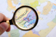 Where is Slovenia?. Searching Slovenia on map with loupe Royalty Free Stock Photos