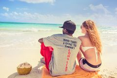 Where there is coconut tree there is long life. Young couple enjoying ocean view Stock Image