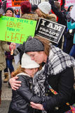 Where There is Love There Is Life. Washington, DC - January 27, 2017: A woman hugs a child during the annual March for Life royalty free stock image