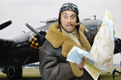 Where to???. WWII figther pilot with map and funny face Royalty Free Stock Image