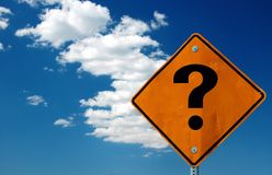 Where to go. Yellow street sign with big question mark against blue sky Stock Photography