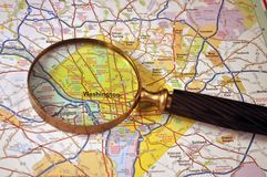 Where to go. This picture illustrate a USA map with a magnifying glass on to of it Stock Image