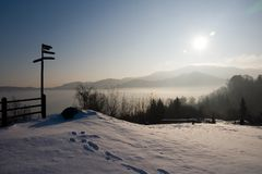 Where to go?. A signpost in a snowy landscape Royalty Free Stock Images