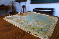 Where to go. Old map on the historic school table Royalty Free Stock Photography