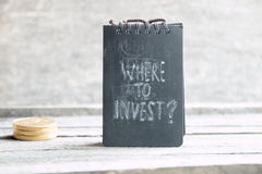 Where To Invest. Investor idea. Where To Invest.Text and gold coins. Investor or business concept Stock Images