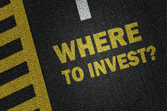Where to invest?. Where to invest on the road Royalty Free Stock Images