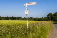 Where To. Landscape - rural spot - field - road - focus on directions for cyclists Royalty Free Stock Photography