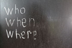 Where, Who, When, - written with white chalk. On a blackboard left part, concept question Stock Images