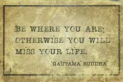 Where you are Buddha. Be where you are; otherwise you will miss your life - famous quote of Gautama Buddha printed on grunge vintage cardboard stock image